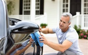 man polishing car